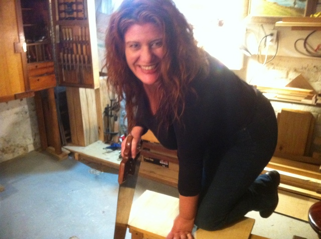 First lesson - Laura saws!