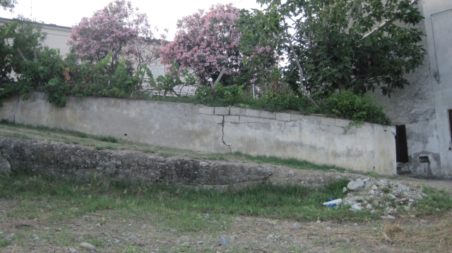 wall along driveway before